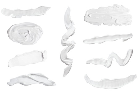 collection of various beauty cream strokes on white background. each one is shot separately Stock Photo