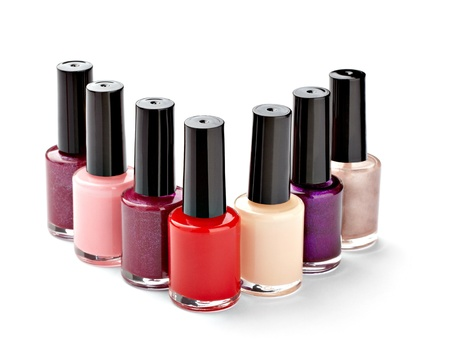 nail polish: close up of nail polish in a row on white background