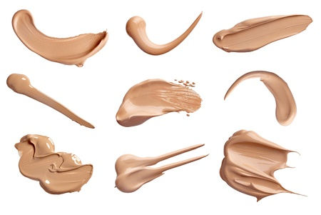 foundations: collection of various make up liquid powder strokes on white background. each one is shot separately