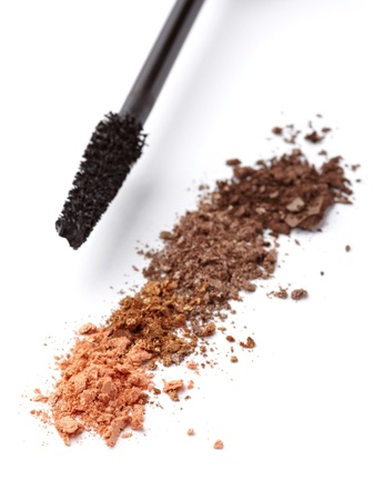 close up of black mascara and face powder on white background Stock Photo - 11007146