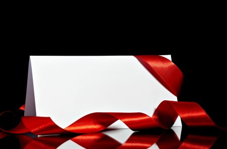 close up of  card note with  ribbon on black background Stock Photo - 11007205