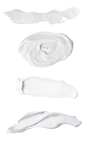 woman face cream: collection of various beauty cream strokes on white background. each one is shot separately Stock Photo