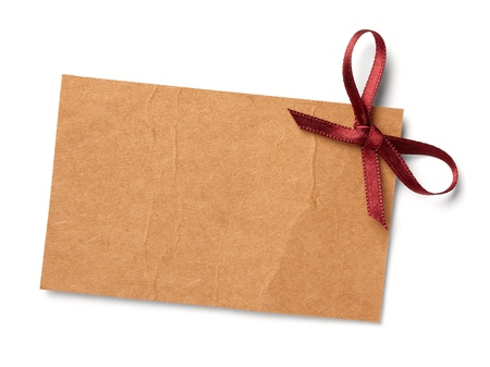 gold string: close up of  card note with  ribbon on white background  with clipping path Stock Photo
