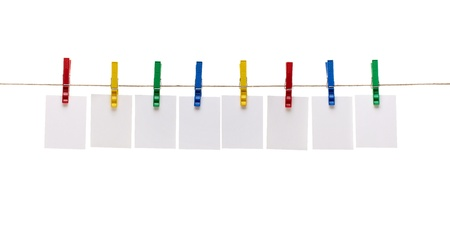 pegs: collection of  various notes and a clothes pegs on white background  Stock Photo