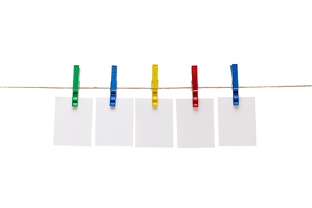 clothes peg: collection of  various notes and a clothes pegs on white background  Stock Photo
