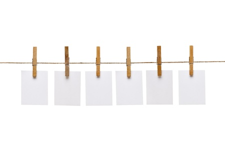 clothes pins: collection of  various notes and a clothes pegs on white background