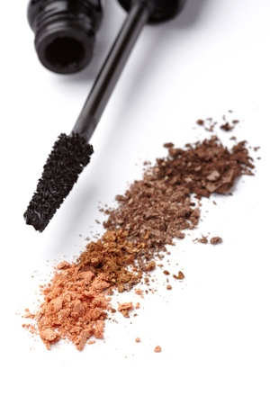 close up of black mascara and face powder on white background Stock Photo - 11310884