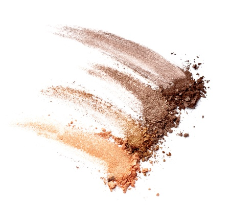 crushed by: close up of  a make up powder on white background