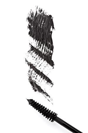 samples: close up of black mascara on white background