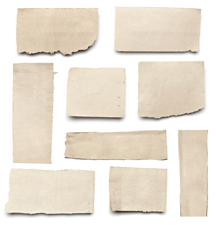 torned: collection of  white ripped pieces of news paper on on white background. each one is shot separately Stock Photo