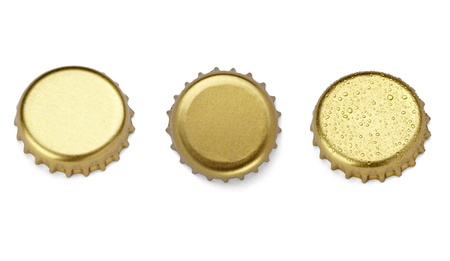 bottle opener: collection of  various bottle cap on white background. each one is shot separately Stock Photo