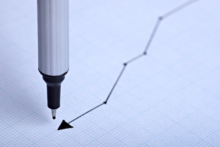 close up of a finance graph on an office desk photo
