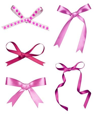 lazo rosa: colecci�n de varios un nudo cinta de seda sobre fondo blanco. cada uno de ellos recibe un disparo por separado