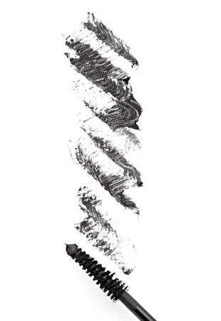 close up of black mascara on white background photo