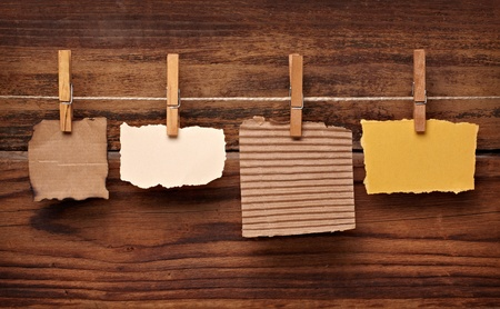clothes peg: close up of  a note paper and clothes peg on a wooden background Stock Photo