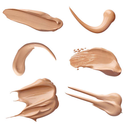 fluids: collection of various make up liquid powder strokes on white background. each one is shot separately