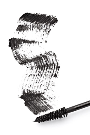 close up of black mascara on white background photo