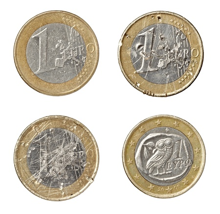 collection of various damaged euro coins on white background. each one is shot separately photo