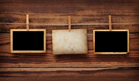 clamps: close up of an old photo and clothes peg on a wooden background Stock Photo