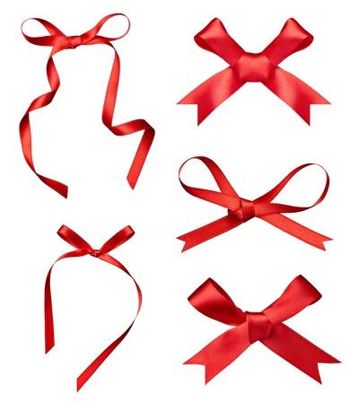 lazo rosa: colecci�n de varios un nudo de cinta de seda sobre fondo blanco. cada uno de ellos recibe un disparo por separado