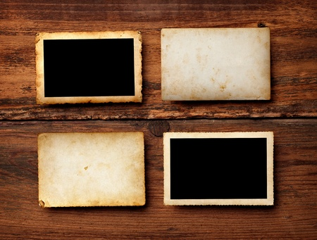 instant film transfer: close up of an old photo on a wooden background
