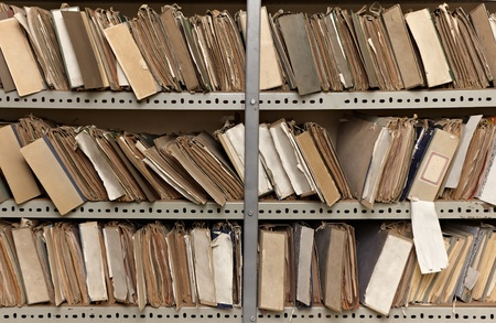 close up of old vintage files in a storage room photo