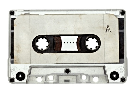 close up of vintage audio tape on white background with clipping path photo