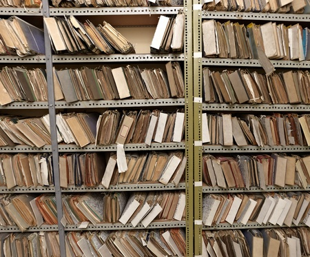 organize: close up of old vintage files in a storage room
