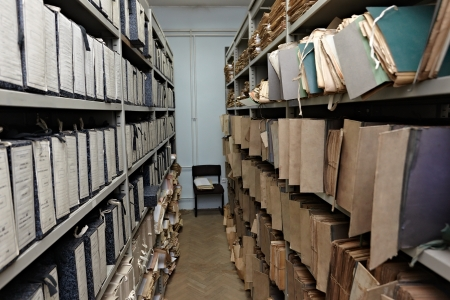 close up of old vintage files in a storage room