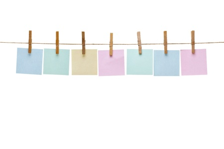 clothes pegs: collection of  various notes and a clothes pegs on white background with clipping path Stock Photo
