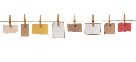 clothes pegs: close up of  a notes and a clothes pegs on white background Stock Photo