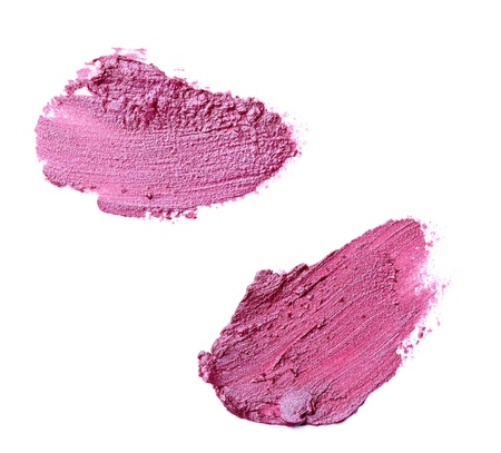 lip stick: close up of  a smudged lipstick on white background