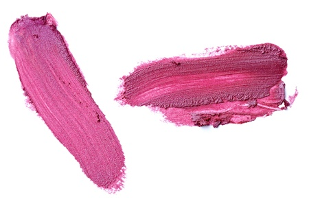 close up of  a smudged lipstick on white background photo