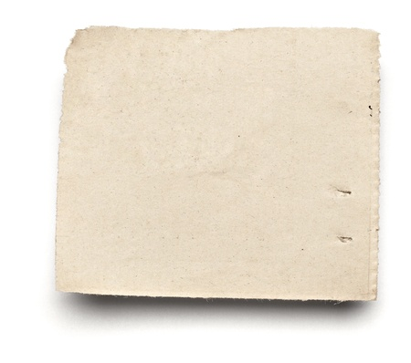 close up of  a white ripped piece of news paper on on white background with clipping path photo