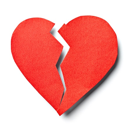 lonely heart: close up of  a paper broken heart on white background with clipping path
