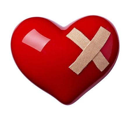 wound care: close up of a heart shape with bandage on white background