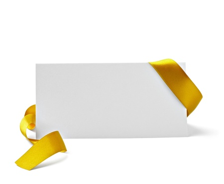 gold bow: close up of  card note with  ribbon on white background  with clipping path Stock Photo