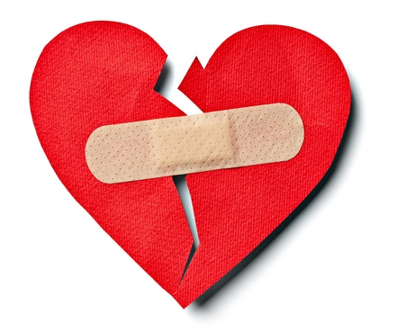 relationship breakup: close up of  aplaster and  paper broken heart on white background with clipping path Stock Photo