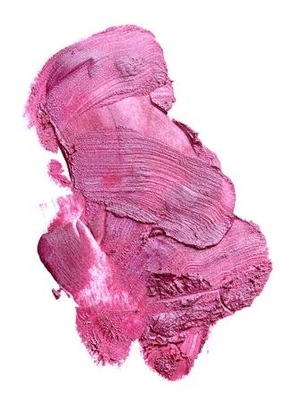 verschmieren: Nahaufnahme von einem Lippenstift verschmiert auf wei�em Hintergrund Lizenzfreie Bilder