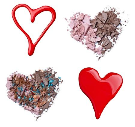 hacer el amor: colección de diversos accesorios de maquillaje sobre un fondo blanco. cada uno de ellos recibe un disparo por separado Foto de archivo