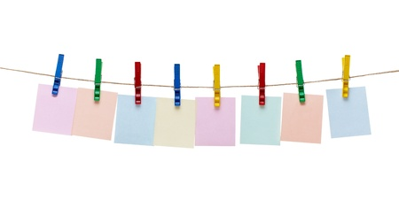 collection of  various notes and a clothes pegs on white background with clipping path photo