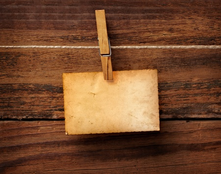 clothes peg: close up of an old photo and clothes peg on a wooden background Stock Photo