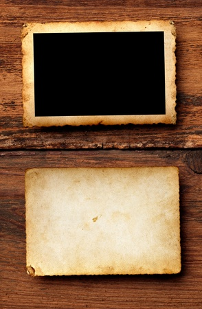 old photo album: close up of an old photo on a wooden background