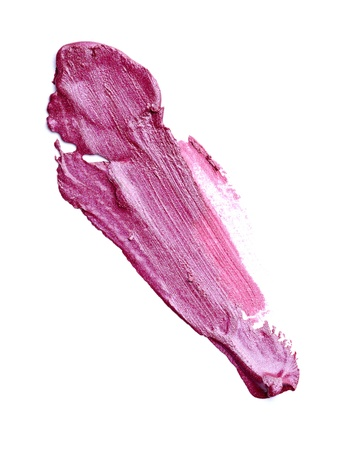 smudge: close up of  a smudged lipstick on white background