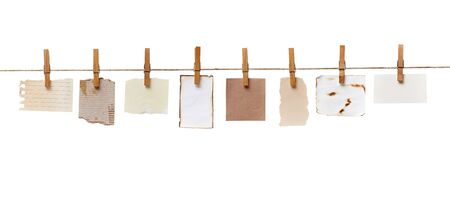 clothespin: close up of  a notes and a clothes pegs on white background Stock Photo
