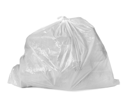 household waste: close up of a garbage bag with empty plastic bottles on white background