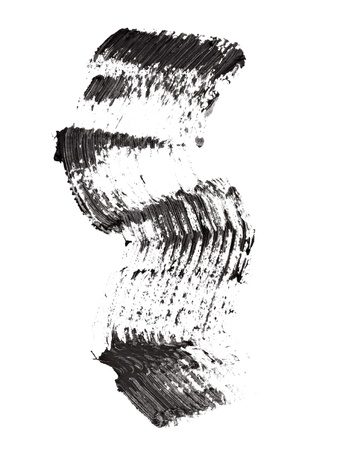 make dirty: close up of black mascara on white background