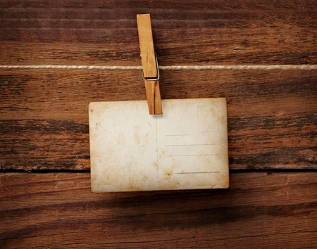 clothespin: close up of an old photo and clothes peg on a wooden background Stock Photo