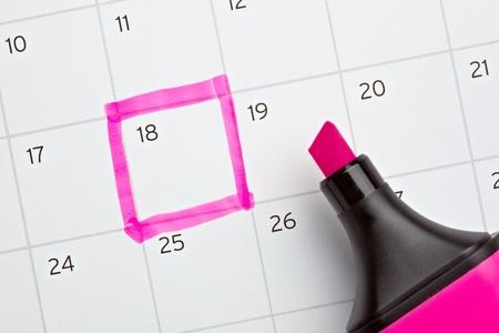 calendar date: close up of a calendar and a marker