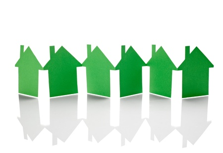 real estate investment: close up of  paper houses on white background